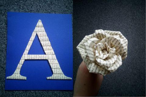 Zu sehen ein A und eine Rose aus alten Buchseiten